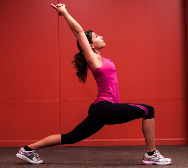 A picture of Kristina Martemucci performing a High Lunge Yoga pose. Kristina is a personal trainer in Binghamton, NY.
